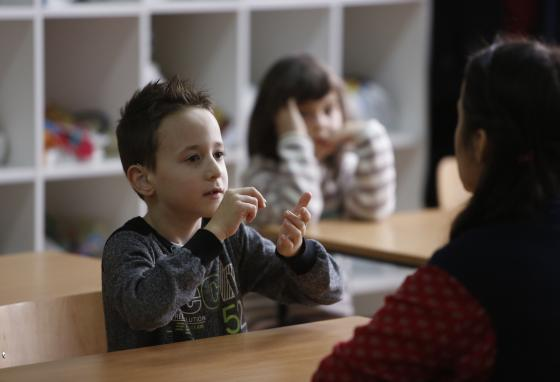 A boy learns sign language in elementary school in Sarajevo, Bosnia. (AP)