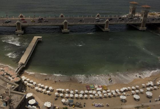 An aerial photo shows beachgoers swimming and sunbathing in Alexandria. (AP)