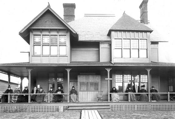 In a late 1800s photo from the Saranac Lake Free Library, tuberculosis patients rest on the porch of a sanatorium. (AP)