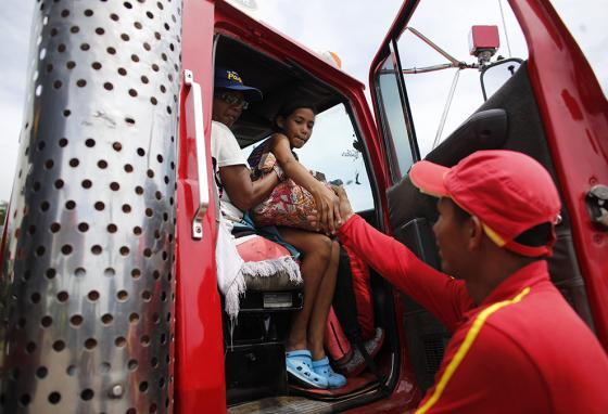 Traveling through Colombia, Ms. Cadiz and Angelis are thankful for sometimes getting a ride in the cab of a truck. (AP)