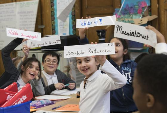Third grade students show off the words they wrote in cursive handwriting. (AP/Mary Altaffer)