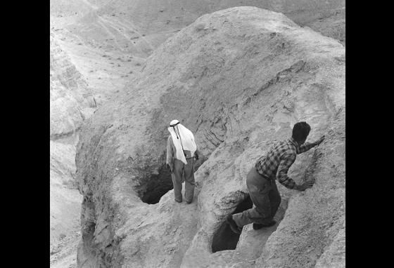 Two men approach the cave in 1957 where the Dead Sea Scrolls were found in Qumran, Jordan. (AP)