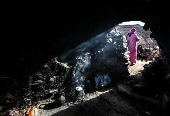 Aesha stands outside the cave where she lives with her family. The descendants of the Berbers, called the Amazigh, still live in Morocco. A few still dwell with their sheep and goats in remote mountain caves. (AP/Mosa'ab Elshamy)