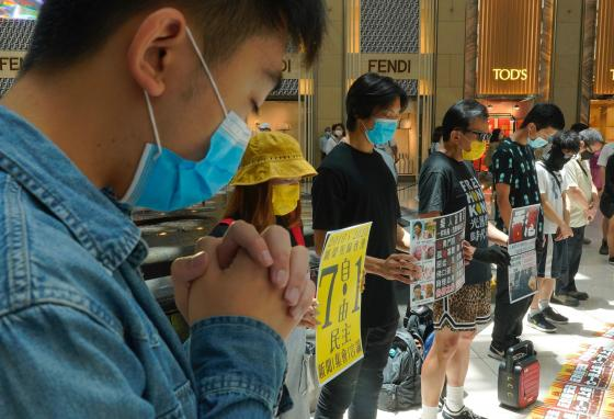 Hong Kongers gather at a shopping mall to protest the new security laws. (AP)