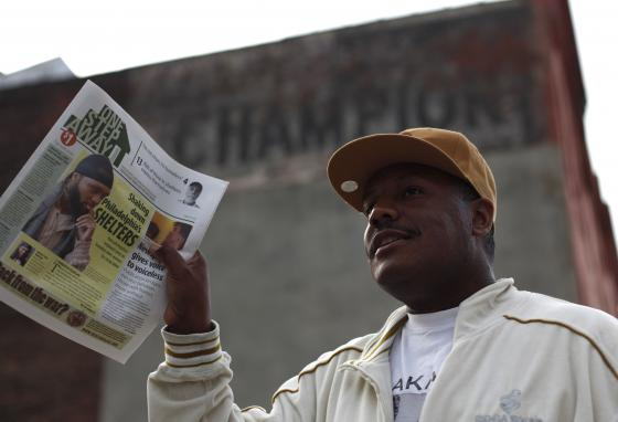 Charlie isn't the only one to create his own newspaper. Claudell Edwards sells a copy of One Step Away, a publication produced and sold by residents of homeless shelters, in Philadelphia, Pennsylvania. (AP/Matt Rourke)