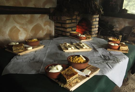 A table with traditional food is set at a farm restaurant that caters to Shar Mountain tourists. (AP/Boris Grdanoski)