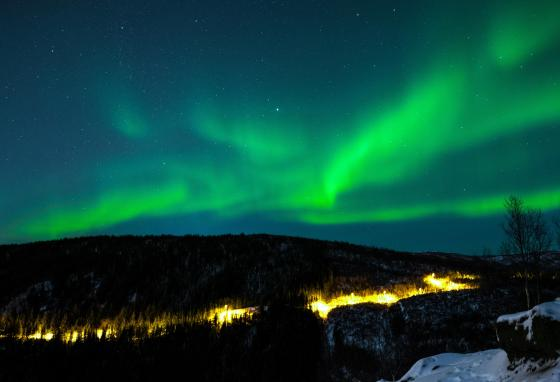 The magnetic field helps create the Northern lights. It steers charged particles from the Sun to the poles. The particles collide and create the lights.