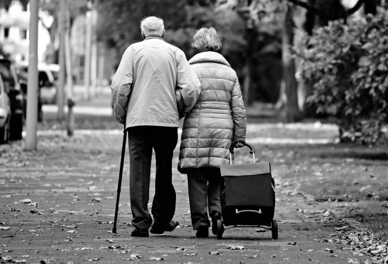 An older couple walks together. Marriage is meant to join a man and a woman together for life.