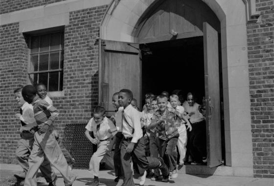 Boys run outside at recess in a school in Washington, D.C. The Supreme Court said segregated schools were unconstitutional and unacceptable in 1954, the year this photo was taken. (AP)