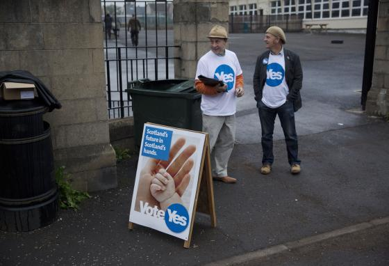 Campaigners for Scottish independence stand outside a polling place in Edinburgh, Scotland before the 2014 referendum. 45% voted to leave the United Kingdom in 2014. (AP/Matt Dunham)
