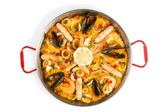 Paella is a traditional seafood and rice dish.