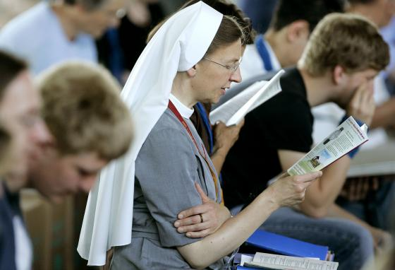 People attend a Bible study in Hanover, Germany. Germans tend to be monochronic. (AP/Jens Meyer)