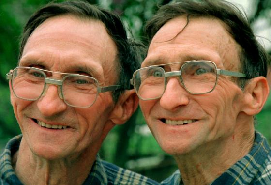 Twins John Reiff, left, and Bill Reiff are shown on their farm in Phoenixville, Pennsylvania. Some twins have up to 100 differences in their DNA. Others have only a few. (AP/Rusty Kennedy)