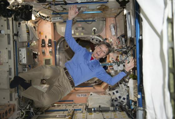 NASA astronaut Peggy Whitson floats aboard the International Space Station. Can you tell which way is up? (AP)