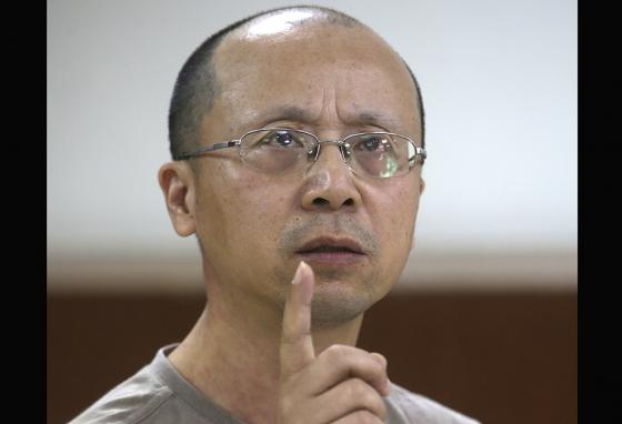 Liao Qiang talks about living under the constant watch of Chinese authorities before arriving in Taiwan. (AP)