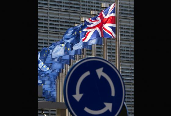 A road sign with UK and EU flags—the picture seems to hint at what's going on as arguments over Brexit go round and round. (AP)