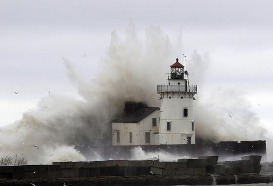 Waves pound a lighthouse on the shores of Lake Erie near Cleveland. (AP)