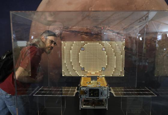 A visitor at NASA's Jet Propulsion Lab looks at a model of one of the CubeSats that hitched a ride on a rocket carrying InSight to Mars. (AP)