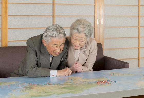 The Emperor and his wife relax, looking at a map. Emperor Akihito says he feels relieved to see his reign coming to an end with the nation at peace. (AP)