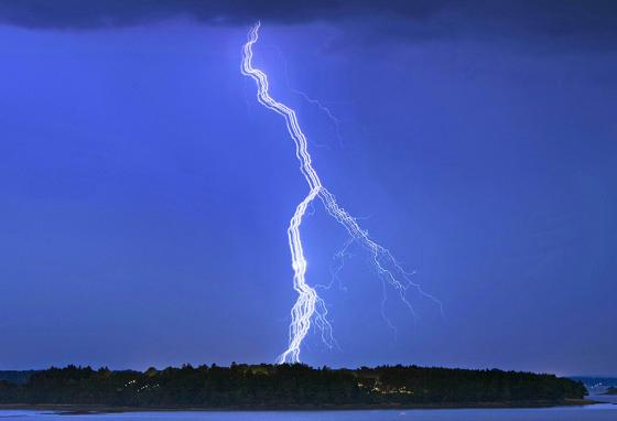 Ribbon lightning looks like it has been spread sideways.  (AP)