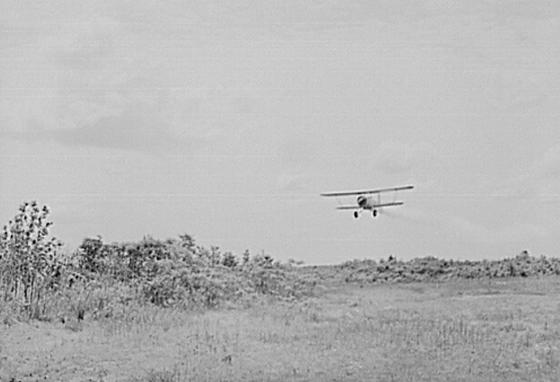 A plane sprays DDT to control mosquitoes in the 1940s. (LOC)