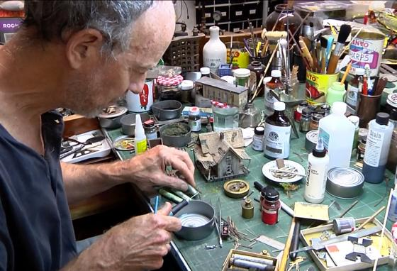 Todd Gieg is surrounded by the glues, paints, brushes, knives, and myriad other tools and materials of the model-making craft. (T. Gieg)