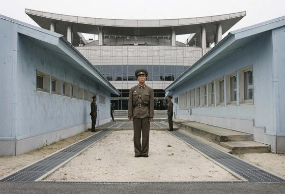 With the actual border strip in front of him, a North Korean soldier stands guard in the border town of Panmunjom. (AP)
