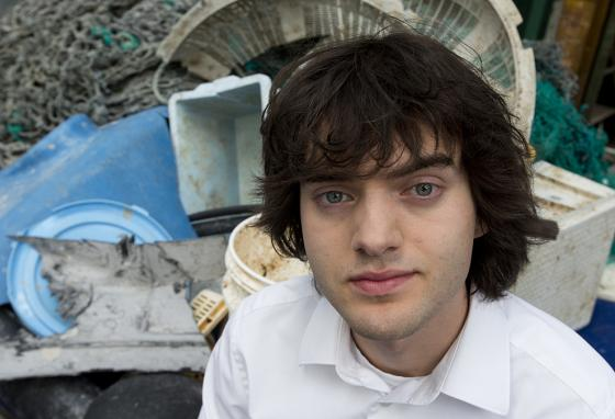 Boyan Slat poses with plastic garbage pulled from the Pacific. (Ocean Cleanup)