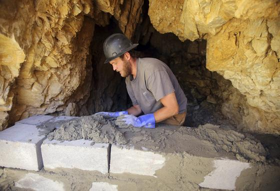 Old mines are sealed using earthmoving equipment, cinder block, or metal grates. (AP)
