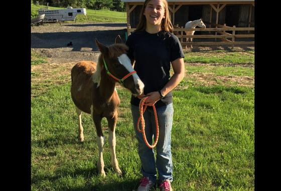 Laura Bagley holds Tug outside the family's backyard stable in Penn Yan, Upstate New York. (C. Boes)