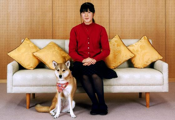 Japanese Princess Aiko poses for a photo with her pet dog Yuri at home in Tokyo. (AP)