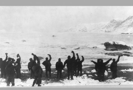 Stranded crew members wave goodbye to Shackleton and sailors as they set sail on the small James Caird boat. (LOC)