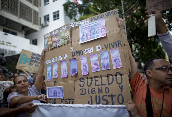 Nurses protest how little their pay will buy. Inflation has made the Bolivar (Venezuelan money) worth almost nothing. (AP)