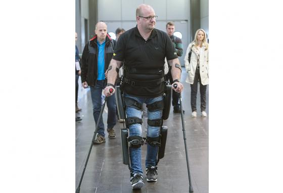 "Some efforts concentrate on exoskeleton technology like this, which ""walks for"" a patient. The Mayo Clinic gets the patient's own body to do the walking. (AP)"