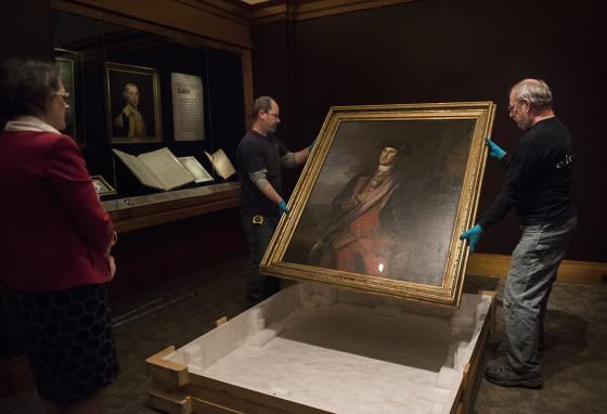Workers uncrate the valuable painting at George Washington's home, Mount Vernon in Virginia. (AP)