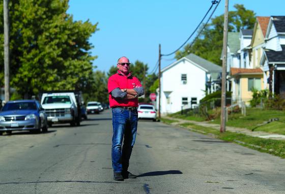 Gary Zaremba stands for a portrait outside a house he oversees. Seven months after the pandemic began, landlords face an even more uncertain future. (AP)
