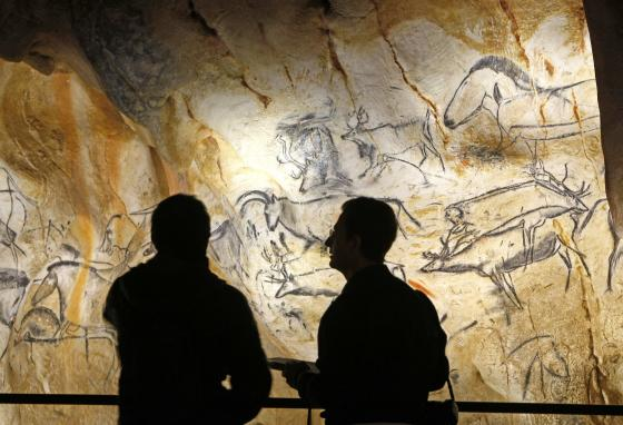 Visitors to the cave replica can see more than 400 paintings of horses, bears, rhinoceroses, and mammoths, plus hand prints and carvings. (AP/Claude Paris)