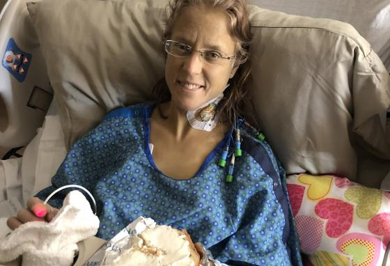 Janet Thorin, a nurse herself, knows a good breakfast will help her recover. But eating is hard work after abdominal surgery. Her skin color is a result of her liver disease.