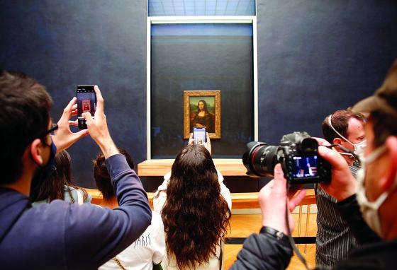 The Mona Lisa hangs in the Louvre Museum in Paris, France. Visitors from all over the world come to see the painting. (AP)