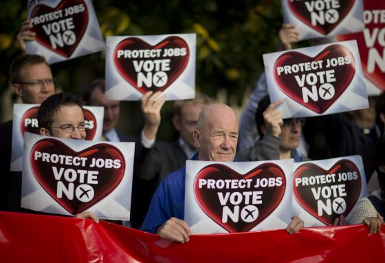 """Supporters against leaving the United Kingdom hold up banners during a rally in Edinburgh, Scotland. The """"No"""" side won in 2014 with 55% of the vote. (AP/Matt Dunham)"""