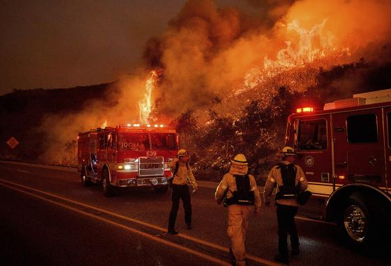 The U.S. Forest Service's new regulations are meant to protect firefighters from the virus as well as their usual job risks. (AP)