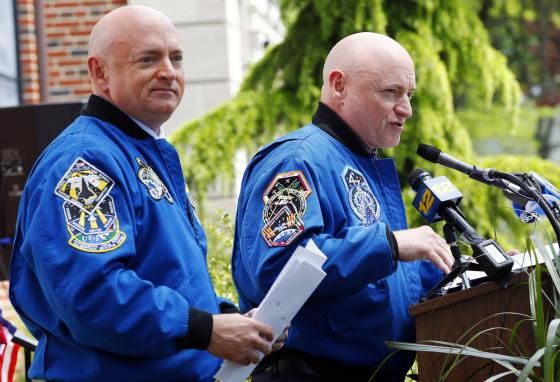 Scott Kelly, right, and his twin brother Mark Kelly attend an event at the elementary school they attended in West Orange, New Jersey, in 2016. (AP)