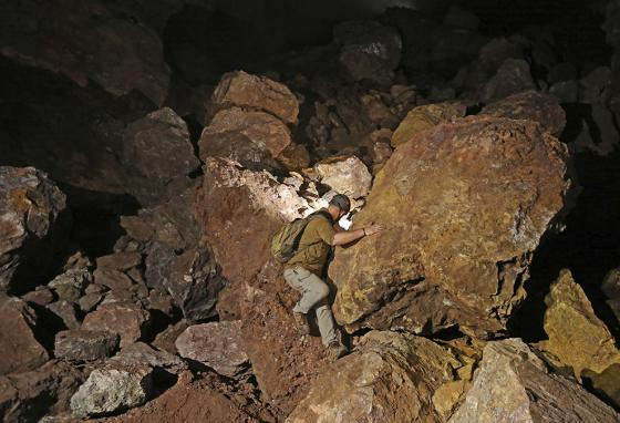 Explorers crawl into tunnels lined with sparkling quartz, century-old rail cars, and caverns that seem like buried ballrooms. (AP)