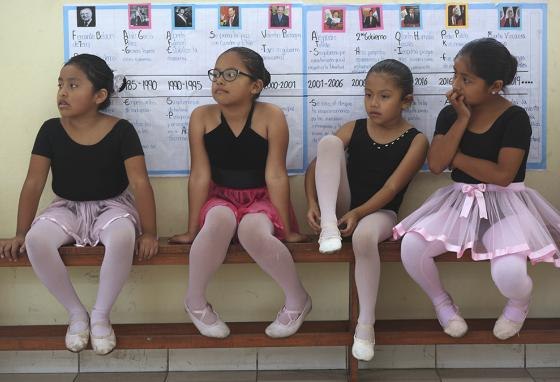 Ballet students wait for the start of their lesson in Lima, Peru. (AP)