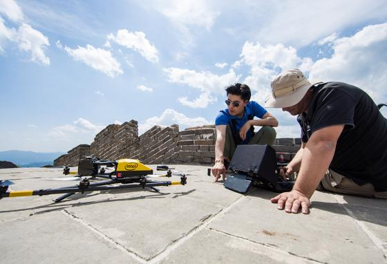 A drone is prepared for a flight to examine crumbling sections of the wall. (Intel)
